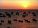 Bình giảng hai khổ cuối bài thơ Đoàn thuyền đánh cá của Huy Cận.