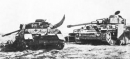 Ý nghĩa bãi xe tăng hỏng trong Chiếc thuyền ngoài xa của Nguyễn Minh Châu - Ngữ Văn 12