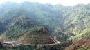 Địa hình vùng núi Trường Sơn Bắc và vùng núi Trường Sơn Nam khác nhau như thế nào ?