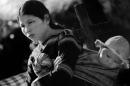 Trong lời ru … người dân yêu nước. Phân tích bài thơ Khúc hát ru những em bé lớn trên lưng mẹ - Nguyễn Khoa Điềm để chứng minh ý kiến trên